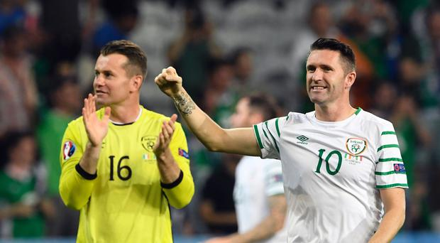 Ireland's forward Robbie Keane (R) and Ireland's goalkeeper Shay Given react after the Euro 2016 group E football match between Italy and Ireland at the Pierre-Mauroy stadium in Villeneuve-d'Ascq, near Lille, on June 22, 2016. / AFP / MIGUEL MEDINA (Photo credit should read MIGUEL MEDINA/AFP/Getty Images)