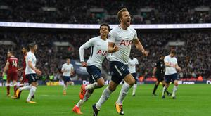 Harry Kane of Spurs (r) celebrates with Dele Ali after scoring the fourth goal and his second of the game during the Premier League match between Tottenham Hotspur and Liverpool at Wembley Stadium on October 22, 2017 in London, England. (Photo by Stu Forster/Getty Images)