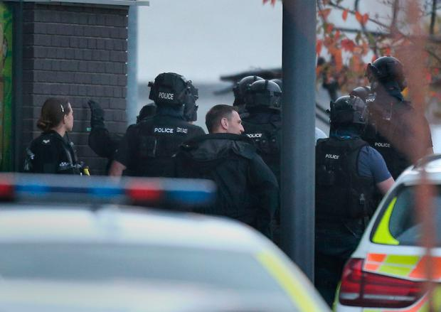 Police at the scene at Bermuda Park in Nuneaton where a gunman is holding two bowling alley members of staff hostage Photo: Aaron Chown/PA Wire