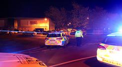 Police at the scene at Bermuda Park in Nuneaton where a gunman was holding two bowling alley members of staff hostage Photo: Aaron Chown/PA Wire