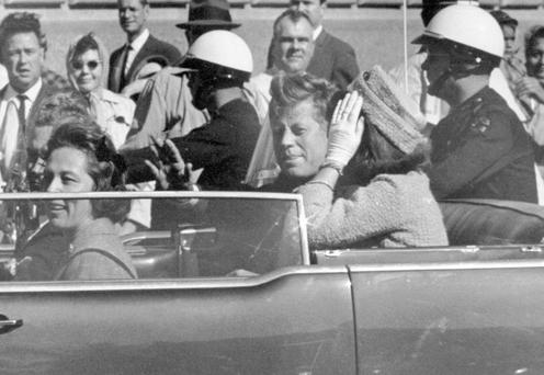 President John F Kennedy waves from his car in a motorcade in Dallas shortly before he was shot. Photo: AP
