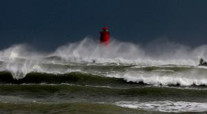 Gales and big waves hit Poolbeg lighthouse in Dublin during Storm Brian. Photo: Sam Boal