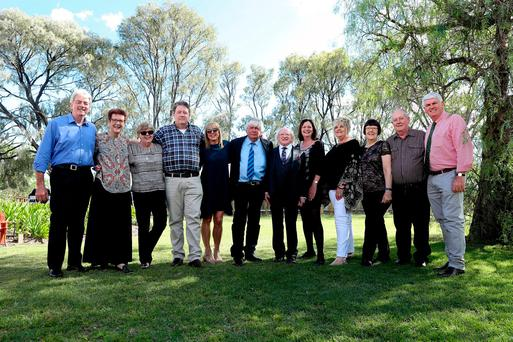 President Higgins meets relatives (from left) John Higgins, Diane McDonald, Denise Cox, Peter Higgins, Helen Byrne, Tom Higgins, Trish Higgins, Sandra Brooks, Margaret Smith, Tom Eastwell, and Peter English at a reception held in Warwick, Australia. Photo: Maxwells