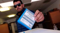 A man casts his vote for Veneto's autonomy referendum at a polling station in Venice, Italy. Photo: REUTERS/Manuel Silvestri