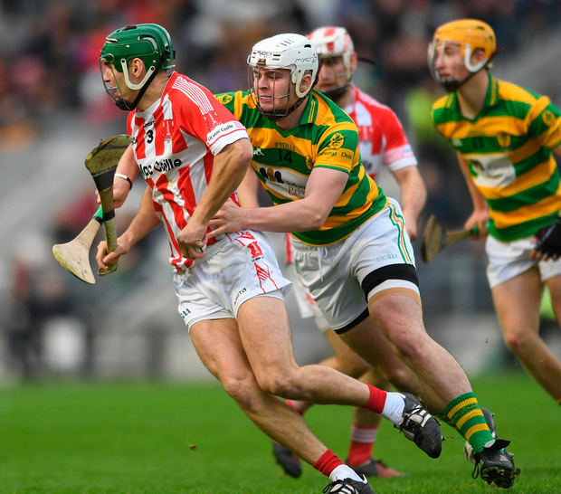Imokelly's Colm Barry tries to give Blackrock's Ciaran Cormack the slip. Photo: Sportsfile