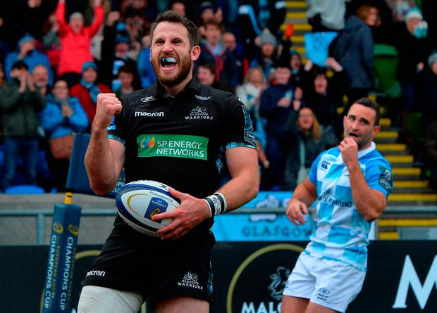 Tommy Seymour of Glasgow Warriors celebrates scoring a try in the second half Photo: Getty