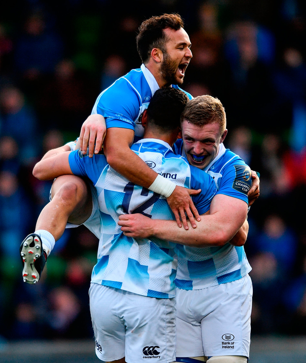 Leinster's Noel Reid celebrates with team-mates Jamison Gibson-Park, left, and Dan Leavy after scoring his side's fourth try Photo: Sportsfile
