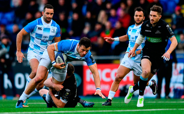 Leinster's Robbie Henshaw is tackled by Finn Russell of Glasgow Warriors Photo: Sportsfile