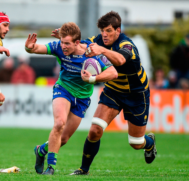 Connacht's Kieran Marmion is tackled by Worcester's Donncha O'Callaghan at the Sportsground Photo: Matt Browne/Sportsfile