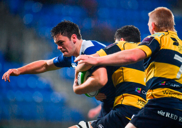 Conor O'Brien of Leinster A is tackled by Sion Bennett, left, and Osian Davis of Cardiff Blues Photo: Sportsfile