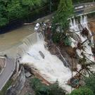 A collapsed road is seen following torrential rain caused by typhoon Lan in Kishiwada, Japan in this photo taken by Kyodo on October 23, 2017. Mandatory credit Kyodo/via REUTERS