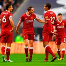 Jordan Henderson of Liverpool argues with Dejan Lovren and Joel Matip
