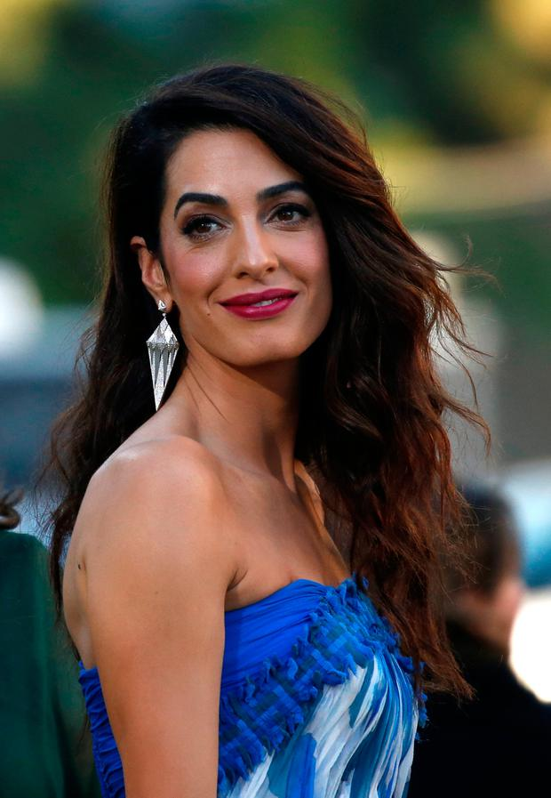 Amal Clooney attends the premiere for