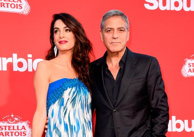 George Clooney (R) and his wife Amal Clooney arrive at the premiere of Paramount Pictures'