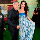 George Clooney and his wife Amal Clooney arrive at the premiere of Paramount Pictures'