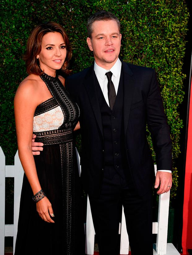 Actor Matt Damon (R) and his wife Luciana Barroso arrive at the premiere of Paramount Pictures'