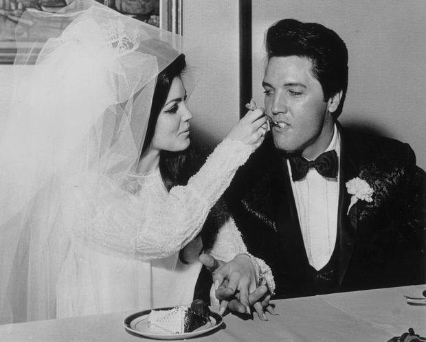 Elvis Presley being fed a mouthful of wedding cake by his bride Priscilla Beaulieu at the Aladdin Hotel, Las Vegas. (Photo by Keystone/Getty Images)