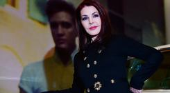 US actress Priscilla Presley poses with Elvis Presley's Lincoln Continental car during a photocall for the 'Elvis at the O2' exhibition in in London on December 15, 2014. AFP PHOTO / BEN STANSALL