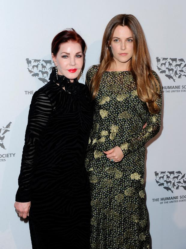 Actresses Priscilla Presley (L) and Riley Keough attend The Humane Society of the United States' to the Rescue Gala at Paramount Studios on May 7, 2016 in Hollywood, California. (Photo by Angela Weiss/Getty Images for The Humane Society Of The United State )