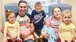 Seamus and Elizabeth Doherty with their newborn twins Sienna and Travis, and the twins' twin sisters Samera and Tameka, and brother Torin at Letterkenny Hospital.