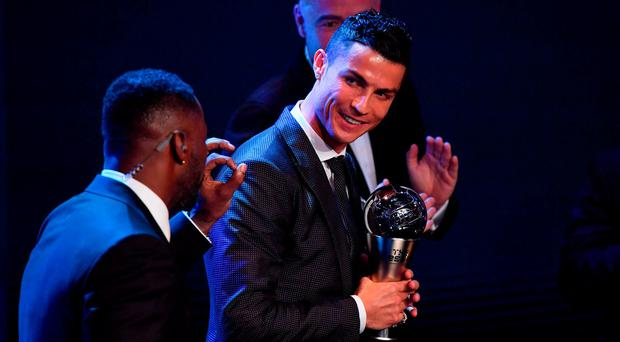 Real Madrid and Portugal forward Cristiano Ronaldo gestures with the trophy after winning The Best FIFA Men's Player of 2017 Award during The Best FIFA Football Awards ceremony, on October 23, 2017 in London.