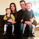 Niamh and David Reid with their daughters Doireann and Eorann