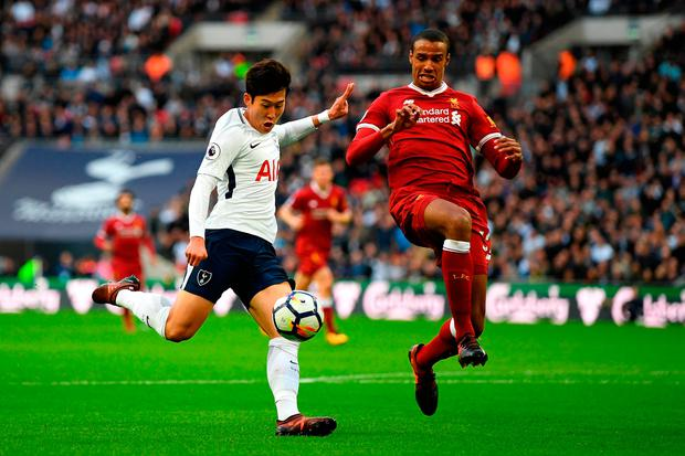 Liverpool's Joel Matip attempts to block a shot from Tottenham's Heung-Min Son. Photo: Shaun Botterill/Getty Images
