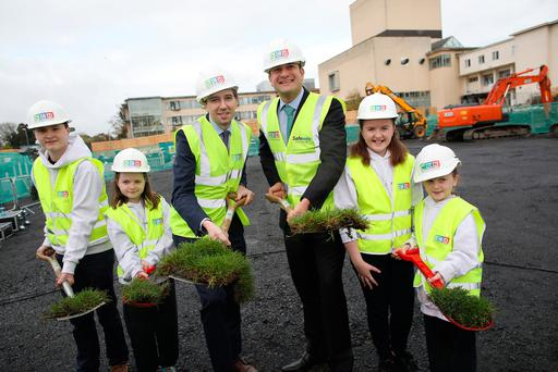 Taoiseach Leo Varadkar TD and Health Minister Simon Harris turn the first sod for the new Paediatric Outpatients and Urgent Care Centre on the grounds of Connolly Hospital, with James Mohan, Ashleigh Kiernan, Matilda Kiernan, and Isabel Kiernan, from the Youth Advisory Council