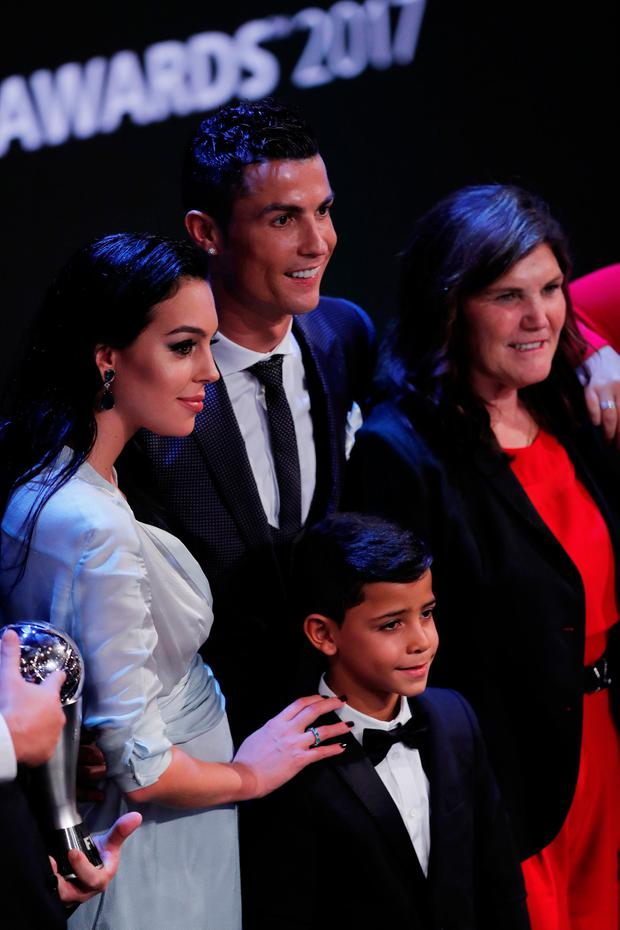 Real Madrid's Cristiano Ronaldo celebrates after winning The Best FIFA Men's Player Award with partner Georgina Rodriguez, son Cristiano Jr. and mother Maria Dolores dos Santos Aveiro REUTERS/Eddie Keogh