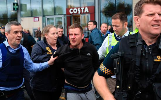 Armed Gardai arrest a man at City west Shopping centre this afternoon after a chase through Tallaght...Picture Colin Keegan, Collins Dublin.
