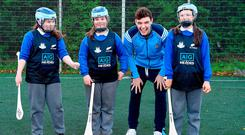 Dublin hurler Eoghan O'Donnell with Sophie Williams, 11, Abbie O'Neill, 12, and Rebecca Baker, 12, at the AIG Heroes initiative at Holy Spirit BNS, Ballymun. Photo by Sam Barnes/Sportsfile