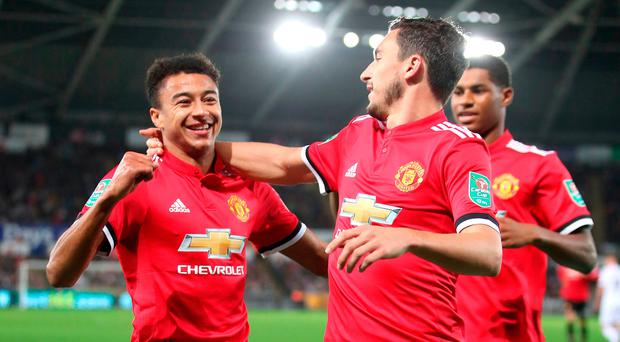 Manchester United's Jesse Lingard celebrates scoring his side's second goal in the last round