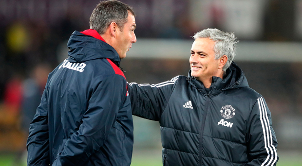 Swansea City manager Paul Clement and Manchester United manager Jose Mourinho. Photo: PA