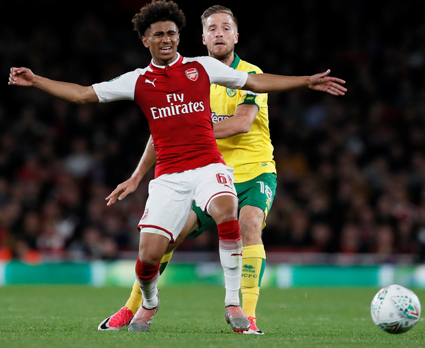 Arsenal's Reiss Nelson fends off Norwich City's. Photo: Reuters