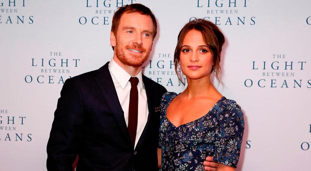 Michael Fassbender and Alicia Vikander. Photo: Isabel Infantes/PA. Inset, photos with fans