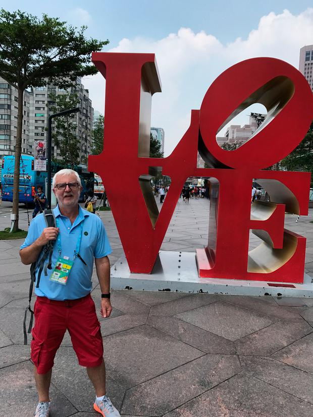Beatles fan John simply couldn't resist having a photo with giant LOVE sculpture