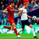 Liverpool's Dejan Lovren (left) and Tottenham Hotspur's Harry Kane (right) battle for the ball during the Premier League match at the Wembley Stadium