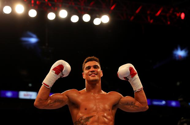 Anthony Ogogo celebrates victory over Frane Radnic of Croatia in a Middleweight contest at The O2 Arena on June 25, 2016 in London, England. (Photo by Richard Heathcote/Getty Images)