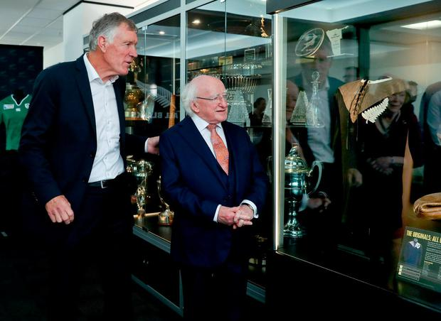 President Michael D Higgins and Maurice Trapp , president of New Zealand Rugby view the All Blacks 1905 jersey worn by Duncan McGregor in the 15-0 win over England. Photo: Maxwell's