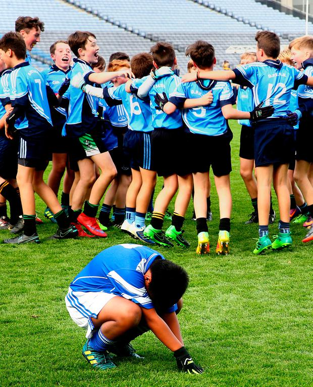 Max Woods of St Patricks National School, Glencullen is dejected after his sides loss to Donabate Portrane Educate Together in the Cumann na mBunsoil football finals in Croke Park. Picture: Gerry Mooney