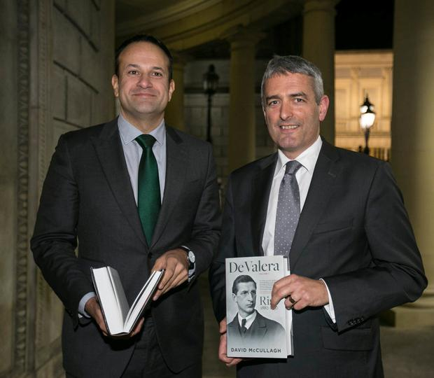 Taoiseach Leo Varadkar with David McCullugh at the launch of the RTÉ broadcaster's book on Éamon de Valera in the National Library. Photo: Mark Condren