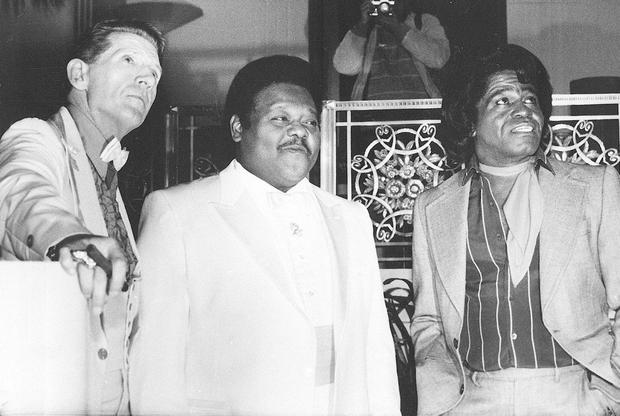 Fats Domino (centre) with Jerry Lee Lewis and James Brown at their induction into the Rock and Roll Hall of Fame in 1986. Photo: G. Paul Burnett/AP Photo