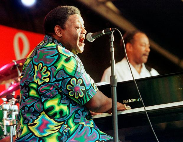 Fats Domino performs at the 30th Annual New Orleans Jazz and Heritage Festival April 25, 1999. Photo: Lee Celano/Reuters