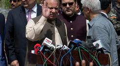 In this June 15, 2017 photo, Pakistan's former Prime Minister Nawaz Sharif waves outside the office of the Joint Investigation Team, in Islamabad, Pakistan. (AP Photo/B.K. Bangash)