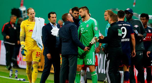 RB Leipzig sporting director Ralf Rangnick clashes with Bayern Munich's Sven Ulreich at half time. REUTERS/Michaela Rehle
