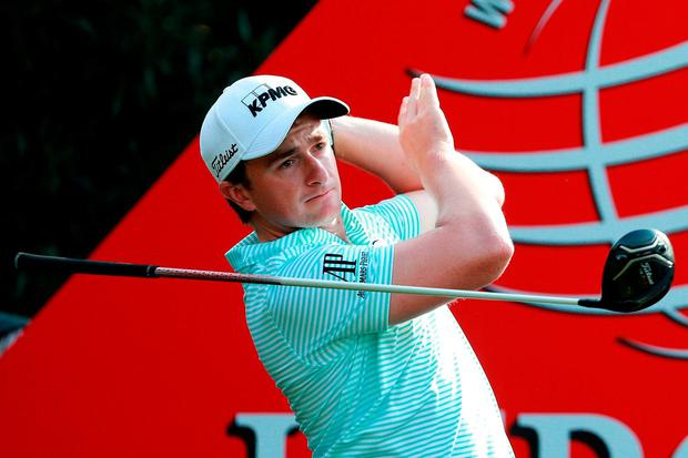 Paul Dunne of Ireland plays his shot from the 18th tee during the first round of the WGC - HSBC Champions at Sheshan International Golf Club
