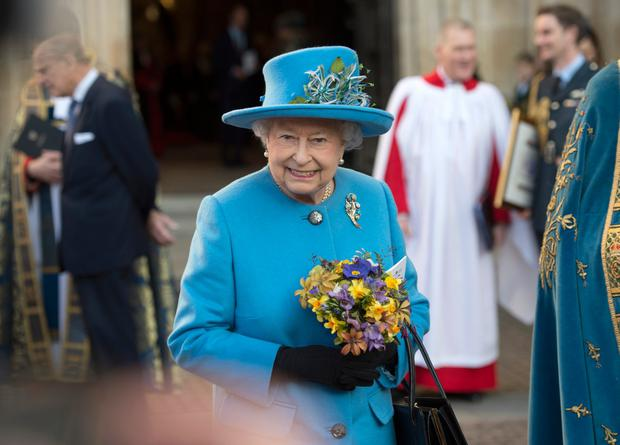 Queen Elizabeth II smiles as she leaves the annual Commonwealth Day service on Commonwealth Day on March 14, 2016 in Westminster Abbey, London