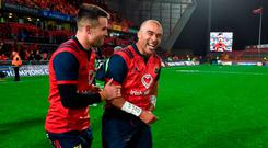 Conor Murray, left, and Simon Zebo of Munster share a laugh as team-mate Dave Kilcoyne is interviewed on the big screen after the European Rugby Champions Cup Pool 4 Round 2 match between Munster and Racing 92 at Thomond Park in Limerick. Photo by Diarmuid Greene/Sportsfile