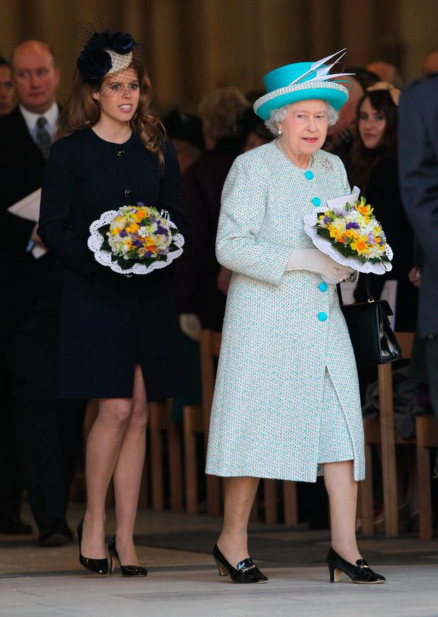 Queen Elizabeth II and Princess Beatrice leave York Minster after a Maundy Thursday Service at on April 5, 2012 in York, England. Queen Elizabeth II, Prince Philip, Duke of Edinburgh and Princess Beatrice are visiting York today as part of the Diamond Jubilee celebrations. (Photo by Chris Jackson/Getty Images)