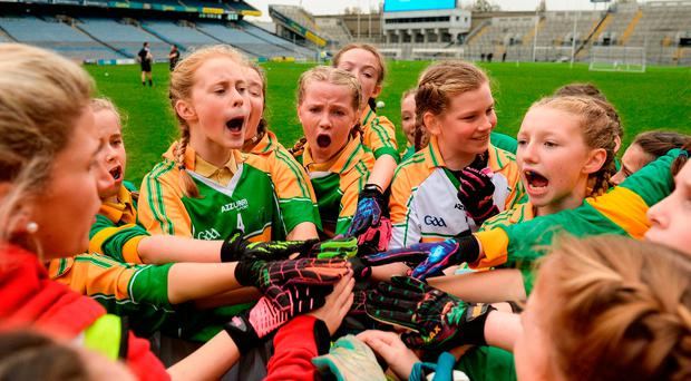 Scoil Oilibhéir Coolmine players huddle up at halftime during their Corn Irish Rubies Final against Bracken Educate Together during the Allianz Cumann na mBunscol Finals at Croke Park in Dublin. Photo by Cody Glenn/Sportsfile